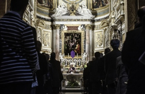 In this picture taken on late Monday, March 30, 2015, devotees attend a Mass for the victims of the Germanwings airliner crash, at the German Santa Maria dell'Anima's Church, in Rome. (AP Photo/Angelo Carconi, Ansa)