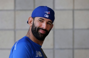 Toronto Blue Jays' Jose Bautista (19) is shown outside the Blue Jays clubhouse before an exhibition baseball game against the Tampa Bay Rays in Dunedin, Fla., Sunday, March 22, 2015. (AP Photo/Kathy Willens)