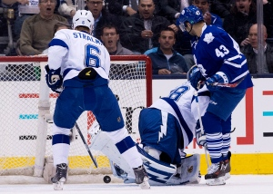 Toronto Maple Leafs forward Nazem Kadri (43) scores past Tampa Bay Lightning goalie Andrei Vasilevskiy (88) and Lightning defenceman Anton Stralman (6) look on during first period NHL hockey action in Toronto on Tuesday, March 31, 2015. (The Canadian Press/Nathan Denette)
