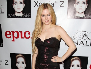 This Nov. 5, 2013 photo released by Starpix shows Canadian singer Avril Lavigne at her album release party in New York. Lavigne's self-titled album was released on Tuesday. (AP Photo/StarPix, Kristina Bumphrey)