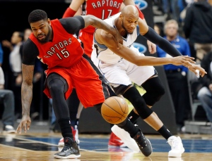 Minnesota Timberwolves' Adreian Payne, right, and Toronto Raptors' Amir Johnson race for the loose ball in the first quarter of an NBA basketball game, Wednesday, April 1, 2015, in Minneapolis. (AP Photo/Jim Mone)