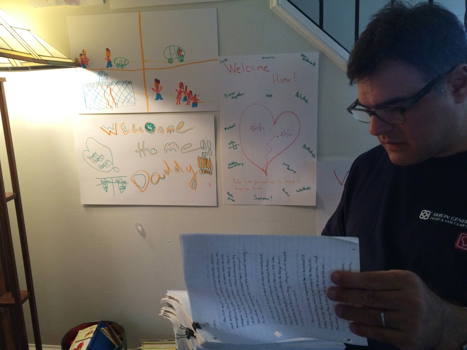 Former CIA agent John Kiriakou, goes through a manuscript about a book on his two years in prison at his home in Arlington, Va. on March 26, 2015. Kiriakou says multiple people within the agency protested the detention, rendition and torture of Canadian Maher Arar, but says they were ruled out. (Alexander Panetta /The Canadian Press)