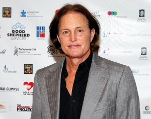 In this Sept. 11, 2013 file photo, former Olympic athlete Bruce Jenner arrives at the Annual Charity Day hosted by Cantor Fitzgerald and BGC Partners, in New York. (Photo by Mark Von Holden/Invision/AP)