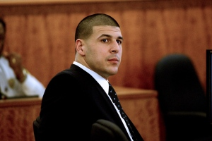 Former New England Patriots football player Aaron Hernandez listens to testimony during his trial in Fall River, Mass., Monday, April 6, 2015. Hernandez is accused of killing Odin Lloyd in June 2013. (AP Photo/The Boston Herald, Ted Fitzgerald, Pool)