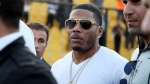 FILE- In March 13, 2015, file photo, U.S. rapper Nelly approaches the stage for a concert in Irbil, northern Iraq. Nelly is facing felony drug charges after being arrested in Tennessee, Saturday, April 11, 2015, according to a Tennessee Highway Patrol news release. (AP Photo/Seivan M. Salim, File)