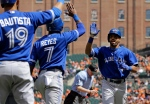 Toronto Blue Jays' Dalton Pompey, right, high-fives teammates Jose Reyes and Jose Bautista after batting in Reyes on a home run in the first inning of a baseball game against the Baltimore Orioles, Sunday, April 12, 2015, in Baltimore. (AP /Patrick Semansky)