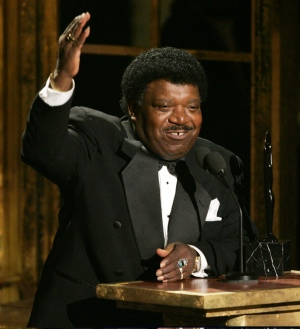 "FILE - In this March 14, 2005 file photo, Percy Sledge accepts his award during the Rock and Roll Hall of Fame induction ceremony in New York. Sledge, who recorded the classic 1966 soul ballad ""When a Man Loves a Woman,"" died, Tuesday April 14, 2015. He was 74. (AP Photo/Julie Jacobson, File)"