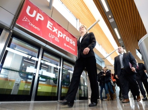 Ontario Premier Kathleen Wynne arrives for the opening announcement for the Union Pearson Express train from Union Station to Pearson airport in Toronto on Wednesday, April 22, 2015. THE CANADIAN PRESS/Frank Gunn