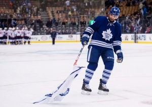 Toronto Maple Leafs forward Nazem Kadri picks up a Maple Leafs jersey on the ice after being defeated by the Washington Capitals during third period NHL hockey action in Toronto on Wednesday, January 7, 2015. The blue-chip Maple Leafs brand has survived bad seasons in the past. But 2014-15 took its toll. THE CANADIAN PRESS/Nathan Denette