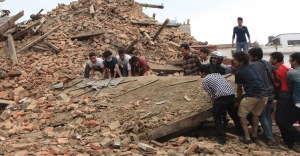 In this April 25, 2015 photo, people try to lift the debris from a temple at Hanumandhoka Durbar Square after an earthquake in Kathmandu, capital of Nepal, Saturday, April 25, 2015. (Sunil Sharma/Xinhua via AP)