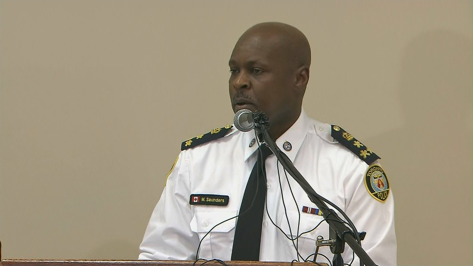 Police Chief Mark Saunders speaks with attendees at the African Canadian Summit on April 29.