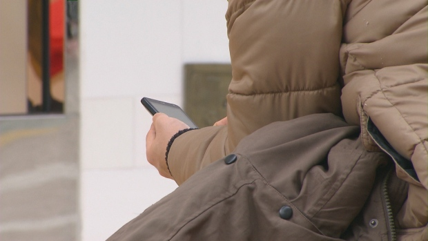 A person uses a smartphone at Union Station in an undated file image.
