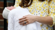 Kate, Duchess of Cambridge holds her newborn baby princess,as she poses for the media as she leaves St. Mary's Hospital's exclusive Lindo Wing, London, Saturday, May 2, 2015. Kate, the Duchess of Cambridge, gave birth to a baby girl on Saturday morning. (AP Photo/Kirsty Wigglesworth)
