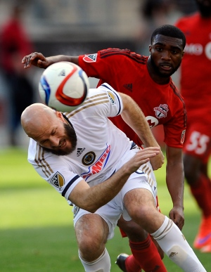 Philadelphia Union forward Conor Casey, left, attempts a shot on goal and collides with Toronto FC defender Ashtone Morgan during the second half of an MLS soccer match, Saturday, May 2, 2015, in Chester, Pa. Toronto FC beat the Philadelphia union 1-0. (AP /Michael Perez)