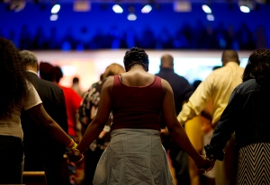 Parishioners holds hands during a moment of prayer at a service at Southern Baptist Church Sunday, May 3, 2015, in Baltimore. (AP /David Goldman)