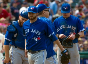 Toronto Blue Jays' starting pitcher Drew Hutchinson walks from the mound after being relieved during the fifth inning of a baseball game against the Cleveland Indians, in Cleveland, Sunday, May 3, 2015. (AP /Phil Long)