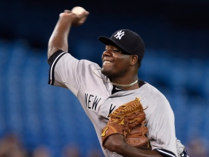New York Yankees starting pitcher Michael Pineda throws against the Toronto Blue Jays during first inning American League baseball action in Toronto, Tuesday, May 5, 2015. (The Canadian Press/Frank Gunn)