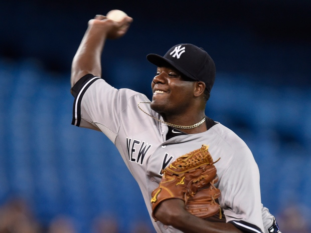 07ae71d4883e New York Yankees starting pitcher Michael Pineda throws against the Toronto  Blue Jays during first inning American League baseball action in Toronto