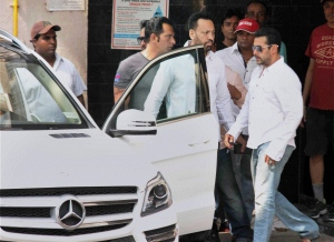 Bollywood actor Salman Khan walks towards a car to head for court in Mumbai, India, Wednesday, May 6, 2015. One of India's biggest and most popular movie stars, Salman Khan, was on Wednesday, May 6, 2015, sentenced to five years in jail after he was found guilty of running over five men sleeping on a sidewalk, killing one in a hit-and-run case that has dragged through the courts for more than 12 years. (Press Trust of India via AP)