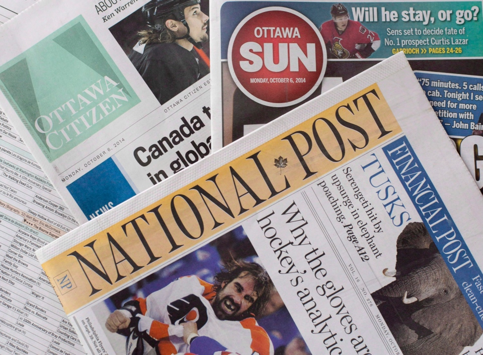 Postmedia newspapers, including the National Post and Ottawa Citizen, are shown with Quebecor Media's Ottawa Sun on Monday, Oct. 6, 2014. (The Canadian Press/Justin Tang)