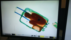 In this photo released by the Spanish Guardia Civil on Friday, May 8, 2015, a boy curled up inside a suitcase is seen on the display of a scanner at the border crossing in Ceuta, a Spanish city enclave in North Africa. (AP Photo/Spanish Interior Ministry, via AP)