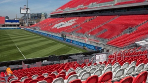 A worker fixes a seat at Toronto FC's BMO Field on Thursday, May 7, 2015. THE CANADIAN PRESS/Chris Young
