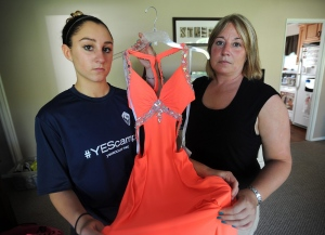 In this photo taken May 11, 2015, Shelton High School sophomore Kylee Opper, 15, left, and her mom Tricia Marini, hold one of two prom dresses that they purchased which have been deemed inappropriate according to a newly announced prom dress code at the school in Shelton, Conn. School officials made national headlines when they announced over the intercom last Friday that dresses that were backless, showed midriff or had cutouts on the side would be considered inappropriate and not be allowed at prom. (Brian A. Pounds/The Connecticut Post via AP)