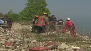 Firefighters work to rescue a girl stranded on a cliff at Scarborough Bluffs Monday May 18, 2015.