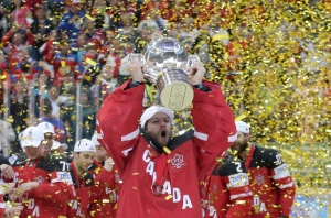 Canada's goalkeeper Mike Smith lifts the trophy after his team defeated Russia in the Hockey World Championships gold medal match in Prague, Czech Republic, Sunday, May 17, 2015. (AP /Petr David Josek)