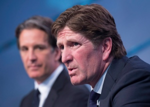 Toronto Maple Leafs new head coach Mike Babcock, right, speaks to reporters with president Brendan Shanahan during a press conference in Toronto on Thursday, May 21, 2015. THE CANADIAN PRESS/Darren Calabrese