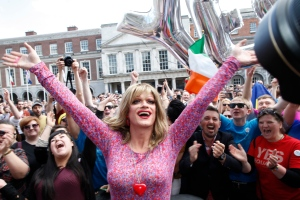Rory O'Neill, known by the Drag persona Panti, celebrates with yes supporters at Dublin Castle, Ireland, Saturday, May 23, 2015. (AP /Peter Morrison)