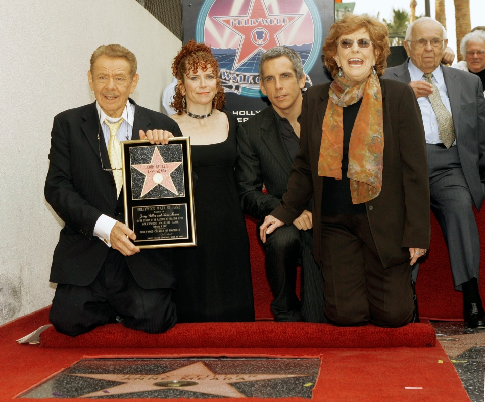Actors Jerry Stiller, far left, and Anne Meara, second from right, pose with their children, Ben Stiller and Amy Stiller Friday, Feb. 9, 2007, as they are honored with a star of the Hollywood Walk of Fame in Los Angeles. (AP /Damian Dovarganes)
