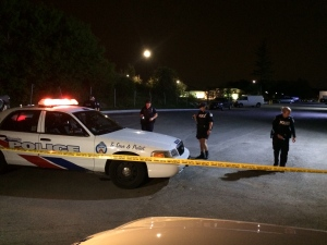 Police secure the scene of a shooting that sent two people to hospital in the Kennedy Road and Steeles Avenue area Sunday May 24, 2015. (Tracey Tong /CP24)