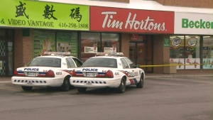 Two police cruisers are shown at the scene of a robbery at a Tim Hortons in Scarborough on Monday morning.