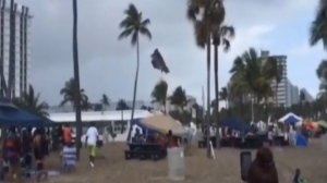 A waterspout lifted an inflatable bouncy castle high over a south Florida beach on Monday.