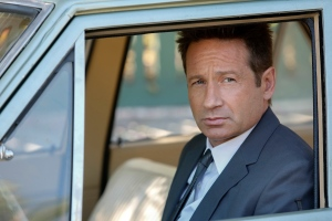 "This photo provided by NBC shows David Duchovny as Sam Hodiak in a scene from the episode, ""Home is Where You're Happy,"" from the new NBC television series, ""Aquarius."" Duchovny plays a Los Angeles police detective working a case involving Charles Manson which premieres Thursday, May 28, 2015, at 9 p.m. EDT. (Vivian Zink/NBC via AP)"