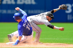 Toronto Blue Jays Kevin Pillar slides in safely to second base past Chicago White Sox Carlos Sanchez during seventh inning American League baseball action in Toronto on Wednesday, May 27, 2015. (The Canadian Press/Frank Gunn)