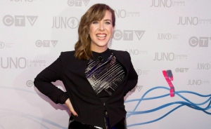 Serena Ryder arrives on the red carpet during the Juno Awards in Winnipeg, Sunday, March 30, 2014. Canadian artist Ryder has lent her voice to the official song of the Toronto 2015 Pan Am and Parapan Am Games. THE CANADIAN PRESS/John Woods