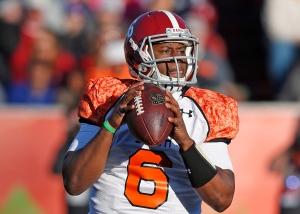 Alabama quarterback Blake Sims (6) drops back to pass in the first half of the Senior Bowl NCAA college football game Saturday, Jan. 24, 2015, in Mobile, Ala. (AP Photo/Butch Dill)