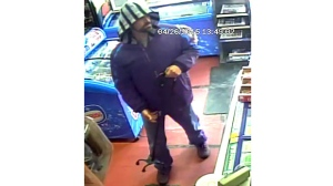 A security camera image of the suspect in two failed convenience store robberies last month.