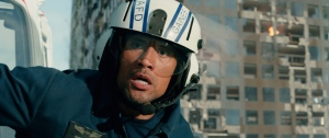 """This photo provided by Warner Bros. Pictures shows Dwayne Johnson as Ray in a scene from the action thriller, """"San Andreas."""" The movie releases in theaters on May 29, 2015. (Courtesy Warner Bros. Pictures via AP)"""