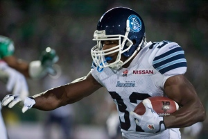 Toronto Argonauts slotback Andre Durie runs the ball against the Saskatchewan Roughriders during the second half of CFL football action in Regina, Sask., Saturday, Sept. 14, 2013. (Liam Richards /The Canadian Press)