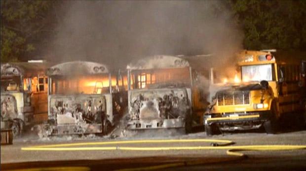 School buses burn at a yard on Dundas Street in Burlington Monday morning.