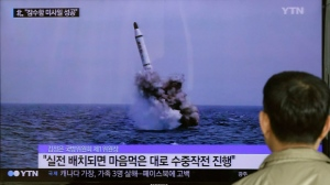 In response to this image of North Korea's ballistic missile believed to have been launched from underwater, South Korea tested a missile of its own, capable of striking any part of North Korea. (AP Photo/Ahn Young-oon)