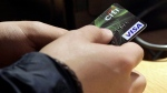 A man holds a Citi Visa credit card on May 9, 2012. (AP/Richard Drew)
