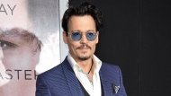 """In this April 10, 2014 file photo, Johnny Depp arrives at the LA Premiere  Of """"Transcendence"""" in Los Angeles. (Photo by Richard Shotwell/Invision/AP, File)"""