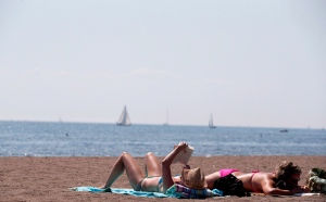 People read as they sunbathe on a warm summer day at Cherry Beach in Toronto on August 23, 2012.  THE CANADIAN PRESS/Michelle Siu