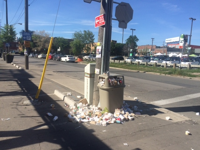Garabge is shown overflowing from a trash receptacle in Liberty Village on Sunday following a mac and cheese festival in the neighbourhood. (Kellie Davenport)