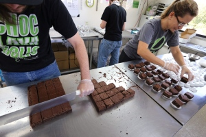 In this Sept. 26, 2014 photo, smaller-dose pot-infused brownies are divided and packaged at The Growing Kitchen, in Boulder. (AP /Brennan Linsley)