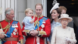 Britain's Prince William holds his son Prince George as they leave the balcony following the Trooping The Colour parade at Buckingham Palace, in London, Saturday, June 13, 2015. (AP /Tim Ireland)